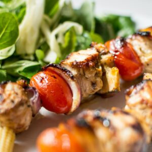 Colorful grilled chicken skewers